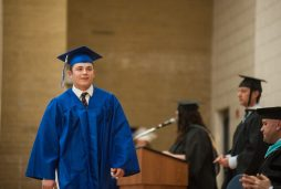 John C. Minella walks to the stage to receive his diploma. | William Camargo/Staff Photographer