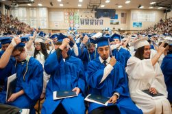 Graduates turn their tassels to signify they graduated from high school. | William Camargo/Staff Photographer