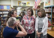 Peg Adamcyzk and Nancy Bolen (at right) share memories with a former student during a recent retirement party held in their honor at Congress Park School. | William Camargo/Staff Photographer