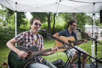 Frankie Monacella and Chris Ulrich from the band Sweet Talks perform at the Brookfield Farmers Market. | William Camargo/Staff Photographer