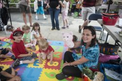 Clara D'Onofrio uses a pig hand puppet to teach children songs. | William Camargo/Staff Photographer