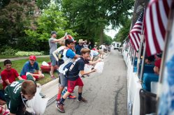 Kids lining the parade route on Longcommon Road in Riverside on Monday, July 4, try to get the attention of parade participants in a quest for a suitable candy haul. | WILLIAM CAMARGO/Staff Photographer