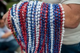 American colored beads are given out during the Riverside annual 4th of July parade. | WILLIAM CAMARGO/Staff Photographer