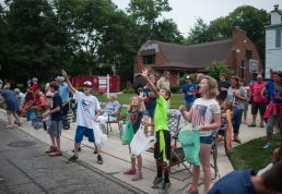 Children grab candy from participants of the parade during the annual 4th of July in Riverside. | WILLIAM CAMARGO/Staff Photographer