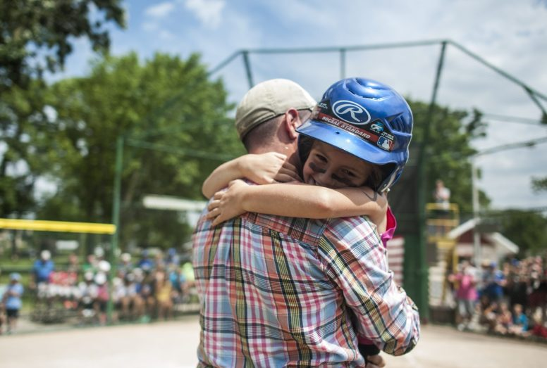 Aubree Isdale, gives a big hug to her dad, Adam, who surprised his daughter just a short time after he returned from a long overseas deployment with the U.S. Army in Kuwait on the afternoon of July 10 at Kiwanis Park in Brookfield. Aubree was part of a North Riverside team playing in the finals of a 7- and 8-year-old girls softball tournament at the field. Adam Isdale is an RBHS graduate and longtime area resident. | William Camargo/Staff Photographer