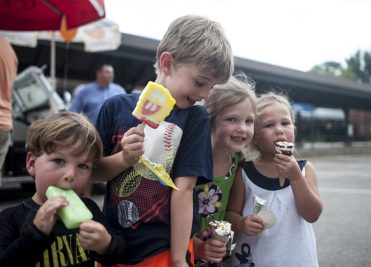 Tommy, Dylan, Avery and Emma Strobel enjoy ice cream during a hot day at Riverfest. | William Camargo/Staff Photographer