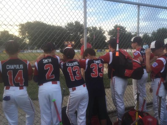 Several members of the Riverside 11U Little League baseball team intently watch game action from the dugout. (Submitted photo)