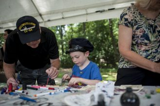Blake Gresens makes some arts and crafts during the 100th Annual Scottish Home Picnic in North Riverside on Aug. 6. | William Camargo/Staff Photographer