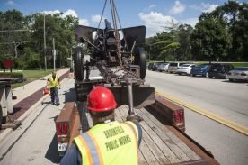The cannon is lowered on to a flat bed trailer. | William Camargo/Staff
