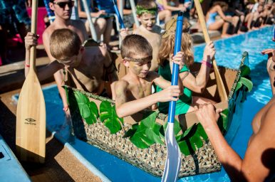 The Jungle Jocks getting ready for the race at the 3rd Annual Cardboard Boat Regatta at the Riverside Swim Club on Saturday, Sept. 3. | William Camargo/Staff Photographer