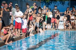 Fans and participants watch as the first cardboard boat enters the water during the 3rd Annual Cardboard Boat Regatta that took place at the Riverside Swim Club. | William Camargo/Staff Photographer