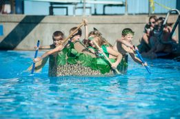 The Jungle Jocks paddle furiously as they head toward the finish of the 3rd Annual Cardboard Boat Regatta at the Riverside Swim Club on Saturday, Sept. 3. | William Camargo/Staff Photographer