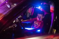 acob Garcia gets comfortable imagining himself chasing bad guys at the wheel of a North Riverside squad car. | William Camargo/Staff Photographer