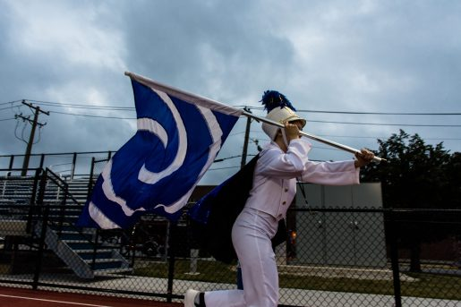 A field commander of the Riverside-Brookfield High School marching band runs with the blue marching bad flag, the adopted color of The Bulldogs.   Sebastian Hidalgo/Contributor