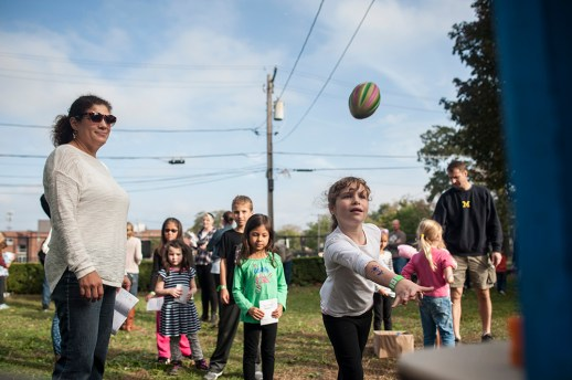 Molly Curtin plays a game during Fall Fest at Hollywood Elementary in Brookfield on Oct. 15.   William Camargo/Staff Photographer