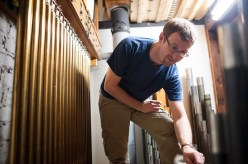 Organ tuner Martin Hill makes some tweaks to the instrument on Oct. 21 in preparation for the Oct. 30. | William Camargo/Staff Photographer