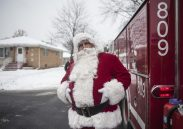 Santa in North Riverside as he made nearly a dozen stops aboard a fire truck during his annual tour to meet the village's children on Dec.17. | William Camargo/Staff Photographer