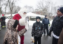 Santa Claus chats with kids during one of his stops in North Riverside on Dec.17. | William Camargo/Staff Photographer