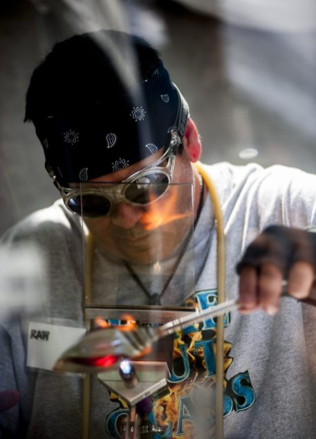 Nick Galette shows his glass blowing skills during the Riverside Arts Weekend at Guthrie Park on May 20. | William Camargo/Staff Photographer
