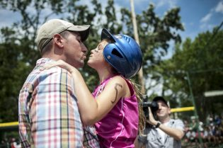 Aubree Isdale, gives a kiss to her dad, Adam, who surprised his daughter just a short time after he returned from a long overseas deployment with the U.S. Army in Kuwait on the afternoon of July 10 at Kiwanis Park in Brookfield, where Aubree was playing in the finals of a girls softball tournament. For more of our favorite photos from 2016, please turn to page 10. | William Camargo/Staff Photographer