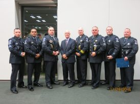 Riverside Village President Ben Sells and Police Chief Thomas Weitzel (center left and right) attended a recent ceremony honoring police officers (from left) Fabian Navarro, Isaac Hamilton, Leo Kotor, Frank Lara, Jim Lazansky and John Cairo.