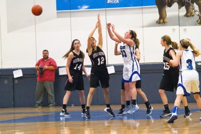 RBHS senior Maggie Shereck (#23), center, has stabilized the Bulldogs' frontline with her defense, rebounding and toughness. (File photo)