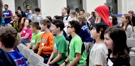Students react to Zimmerman's science tricks. | JACKIE GLOSNIAK/Contributor