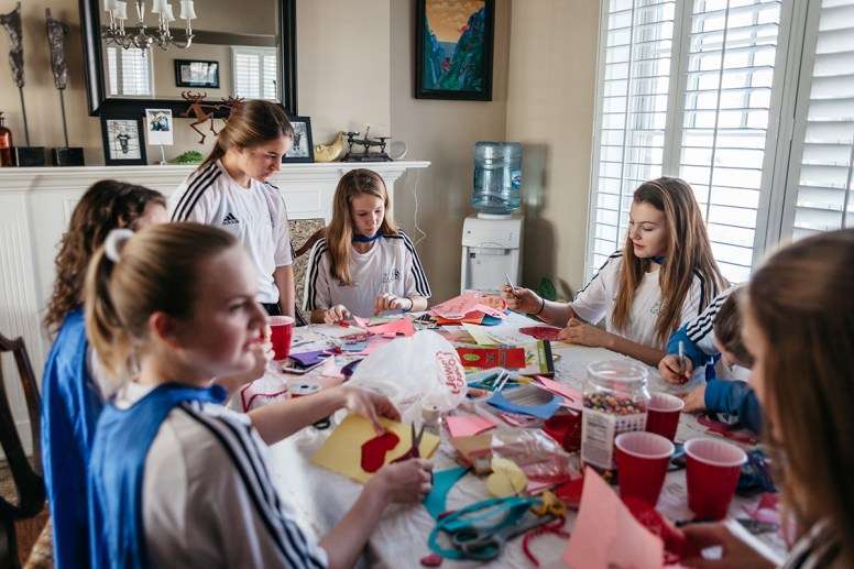 Members of the RBHS girls soccer team gathered on Feb. 12 to make Valentine's Day cards and cookies for residents and staff of Cantata Senior Living Community in Brookfield. | Andrew Block/Buddy's Helpers