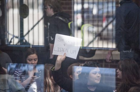 Students packed the atrium at Riverside-Brookfield High School on March 15, staging a sit-in to protest the school's board's decision not to rehire social studies teacher Jill Musil. (William Camargo Staff)