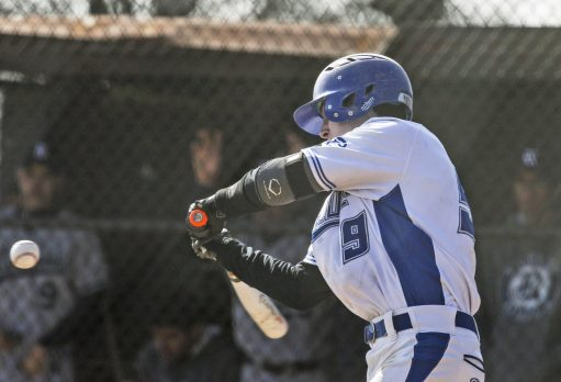 Kyle Fitzgerald #9 swings for a hit during the 2nd inning against Reavis High School on Saturday March 26, 2016 in Brookfield, IL.