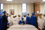 Graduating seniors hang out in the cafeteria before the commencement ceremony at Riverside-Brookfield High School on May 26. | Jason Schumer/Contributor