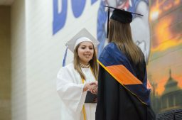 Riverside-Brookfield High School senior Erika Rodriguez accepts her diploma from Principal Kristen Smetana during the RBHS graduation ceremony on May 26 in the school's gym. | Jason Schumer/Contributor