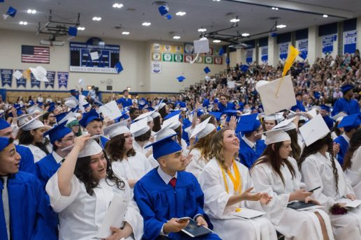 The class of 2017 at Riverside Brookfield High School throws their caps in the air during the ending graduation ceremonies at Riverside-Brookfield High School on May 26. | Jason Schumer/Contributor
