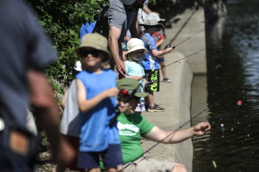 About 40 kids and their parents showed up to fish during the Recreation Department's first-ever kids' fishing derby on June 11. | William Camargo/Staff Photographer