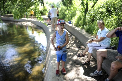 Gavin Sweetser gets ready to reel in some fish from the bank in Swan Pond Park in Riverside during the Recreation Department's first-ever kids' fishing derby on June 11. | William Camargo/Staff Photographer
