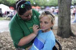 Peyton Reed gets his face painted during Brookfield Zoo's Summer Nights concert on Friday, June 30. | William Camargo/Staff Photographer