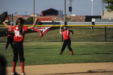 Sophie Kitzler of Riverside Little League's 12-U softball makes a throw during the game against LaGrange on July 7 at Veterans Park in North Riverside. | William Camargo/Staff Photographer