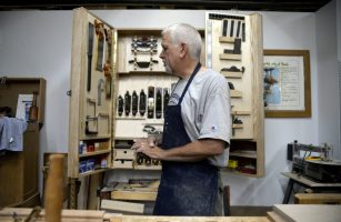 Paul Meyer, designer and craftsman, walks through his shop on Aug. 16. | Alexa Rogals/Staff Photographer