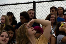 Riverside-Brookfield High School students at the football stadium during the eclipse on Monday. | Sebastian Hidalgo/Contributor