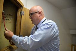 Principal Peter Gatz rings the original bell at dismissal time on Aug. 24, after the first day of school at Central Elementary in Riverside. | Alexa Rogals/Staff Photographer