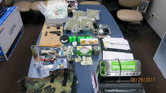 Riverside police reportedly seized these drugs, weapons and paraphernalia from Arturo Rodallegas' Forest Avenue apartment. (Photo courtesy of the Riverside Police Department)