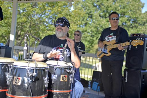 Members of the Chicago-based band, Caliente Old School perform a song for attendees during the Latin Music Fest, organized by the Hispanic Organization of North Riverside (HONR) on Sept. 9 at the Village Commons. | Alexa Rogals/Staff Photographer