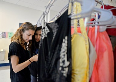 Freshman Ana Santistebani, left, and junior Denise Navarro, both of Riverside, look at dresses displayed on Saturday, Sept. 9, during the RBHS PTO's Fall Flash Boutique at the high school. The school's Parent Teacher Organization received dress donations from students and community members to sell at a discounted price. The money raised from selling dresses will be used for prom tickets for students who are unable to afford it. | Alexa Rogals/Staff Photographer