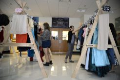Students and parents look at dresses displayed on Saturday, Sept. 9, during the RBHS PTO's Fall Flash Boutique at the high school. | Alexa Rogals/Staff Photographer