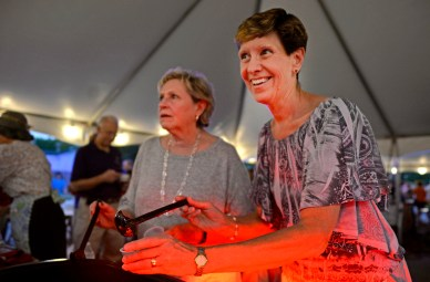 Judy Rizzo and Melissa Dropka, dishes out samples of chili during the fest's chili cookoff. | Alexa Rogals/Staff Photographer