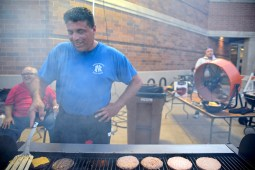 Vince Ranieri, flips burgers for the crowd of hungry visitors. | Alexa Rogals/Staff Photographer