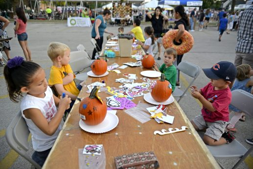 From left, Ava Runquist, 6, Charlier Myers, 5, Ben Myers, 3, and Cameron Kennedy, 2, all of North Riverside, decorate donated pumpkins on Sept. 15, during North Riverside's Autumn Fest. | Alexa Rogals/Staff Photographer