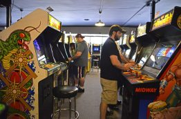 Customers play arcade games on Sept. 25, at the Galloping Ghost Arcade. | Alexa Rogals/Staff Photographer