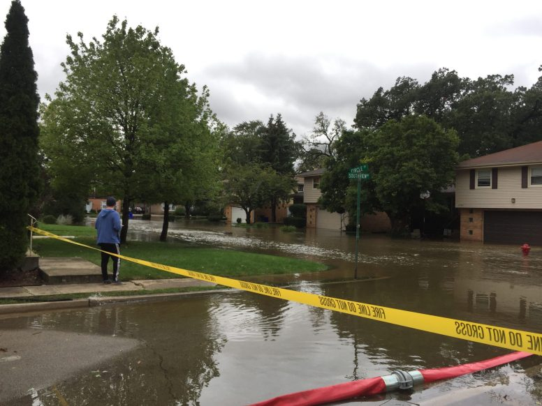 The Lyons Fire department procured a heavy-duty pump from the Cook County department of Homeland Security and was able to pump water from the intersection of Southview and Arden avenues until Salt Creek overtopped its banks. By early Sunday morning that intersection as well as the Cech terrace subdivision in Lyons (above) was underwater. | Bob Uphues/Editor