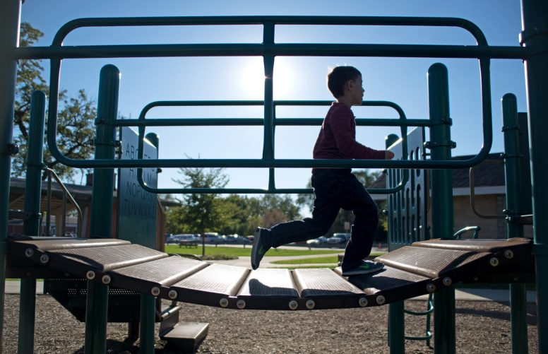 After a rainy weekend kept most everyone indoors, Michael Kulikauskas, 7, of Brookfield, runs through the jungle gym after school at the Kiwanis Park playground on Oct. 16.   Alexa Rogals/Staff Photographer